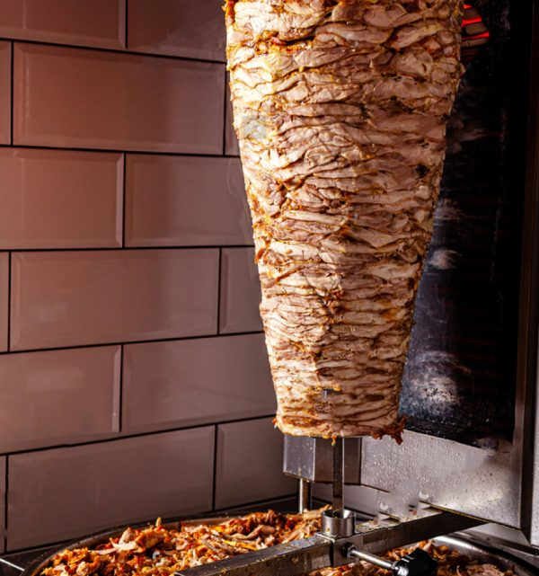 stock-photo-traditional-turkish-oriental-cuisine-chicken-meat-for-doner-kebab-istanbul-chopped-meat-lies-on-1608936286
